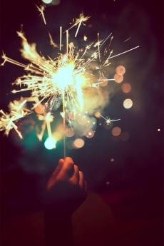 sparkler in hand dark background